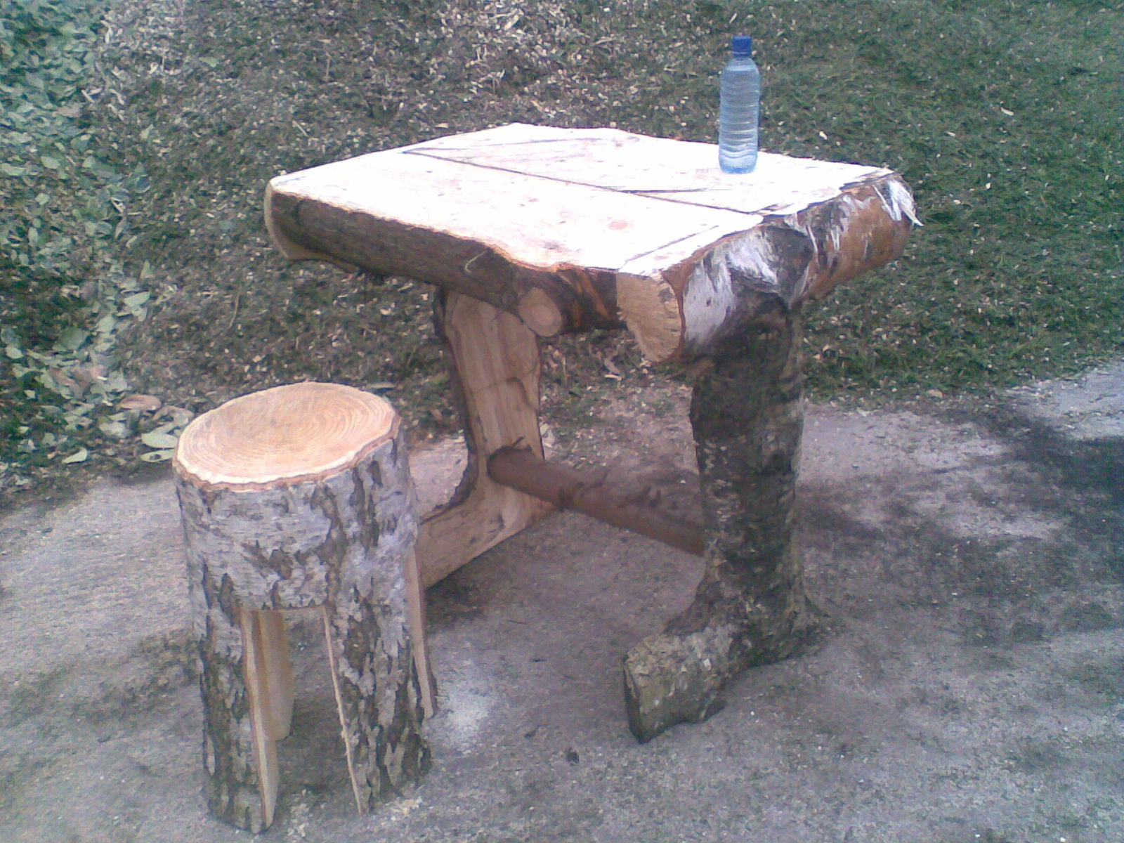 A rustic stool with unique bench